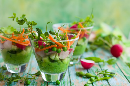 clean dishes: Spring appetizer with raw vegetables and green pea hummus Stock Photo