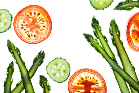 vegetables on white: Thin slices of fresh vegetables on a white background