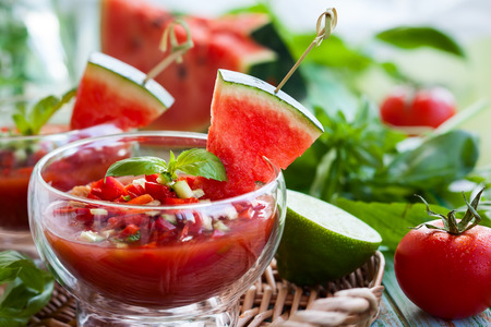 Watermelon tomato gazpacho in  glass bowls Stock Photo
