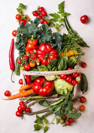 vegetables on white: Basket of fresh vegetables on the white background. Top view