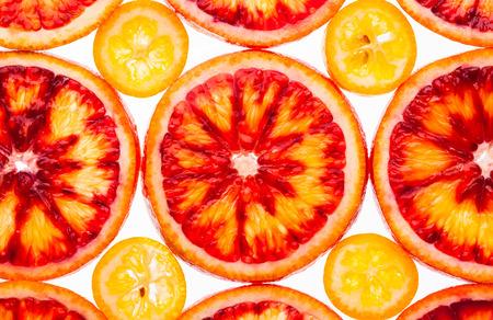 yellow green: Slice of red orange and kumquat on a white background
