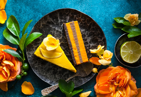 raw: Raw vegan sweet cakes with mango,pineapple, buckthorn and nuts Stock Photo
