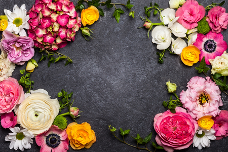 Various flowers on black background. Overhead view with copy space