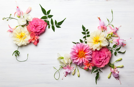 Festive flower composition on the white wooden background. Overhead view 스톡 콘텐츠