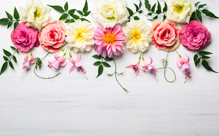 Festive flower composition on the white wooden background. Overhead view Фото со стока - 60926364