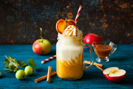 Apple cider float with caramel sauce and stick of cinnamon Stock Photo