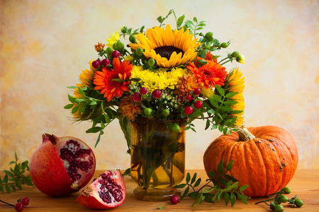 Autumn still life with flowers, pumpkin and fruits Stock Photo