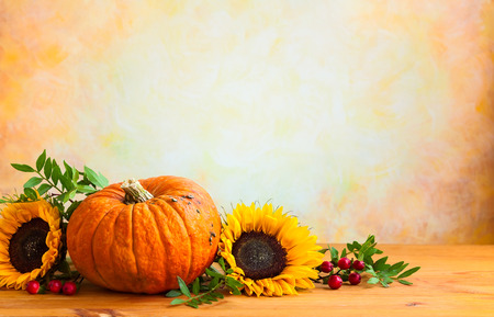 Autumn concept with flowers and pumpkin