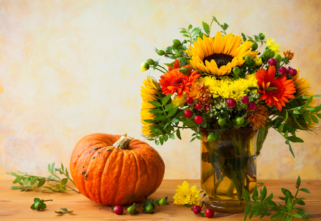 Autumn still life with flowers and pumpkin Stock Photo