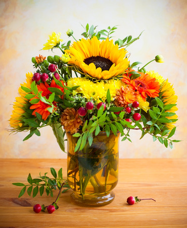flowers in vase: autumnal flowers and berries in a vase Stock Photo