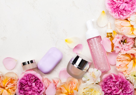 Overhead view of cosmetic set and flowers