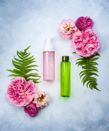 natural therapy: Set of skin care product and flowers Stock Photo