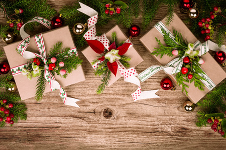 christmas gift: Christmas background with gift boxes and  decorations on wooden board. Top view