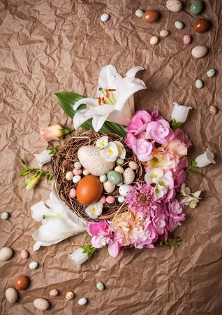Easter composition with festive flowers decoration and traditional treats Stock Photo