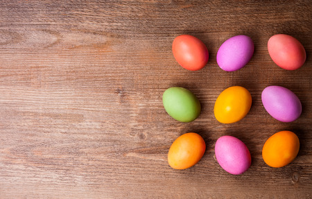 background settings: Natural dyed Easter eggs on old wooden background. Easter concept with copy space. Flat lay