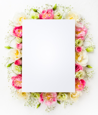 Festive flower concept : beautiful floral border on the white  background with copy space.  Flat lay. Stok Fotoğraf