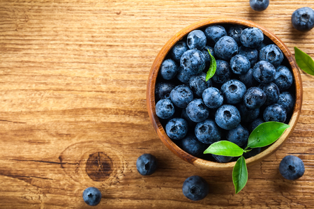 wildberry: Fresh blueberry with drops of water on wooden background. Top view. Concept of healthy and dieting eating Stock Photo