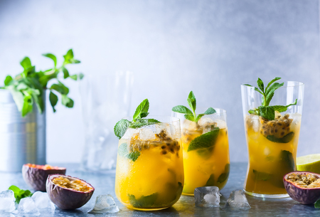 Passion fruit lemonade garnished with lime and mint