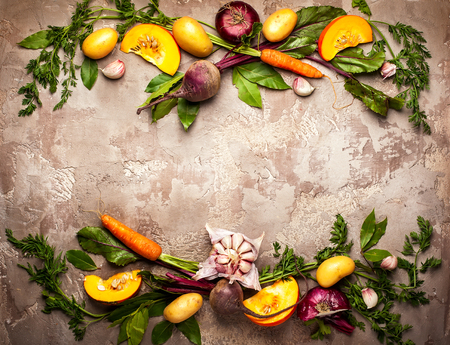 Variety of fresh raw vegetable ingredients for cooking of vegetable soup or stew. Autumn vegetable still life on rustic vintage background. Top view Banco de Imagens - 83229611