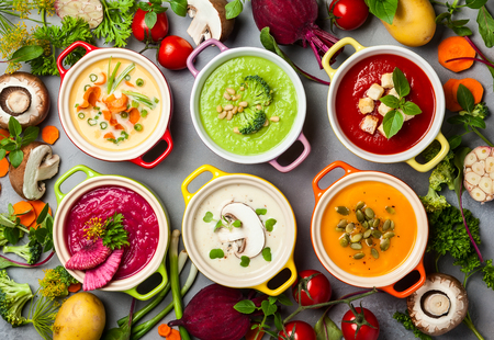 Variety of colorful vegetables cream soups and ingredients for soup. Top view. Concept of healthy eating or vegetarian food. Banco de Imagens - 84866551