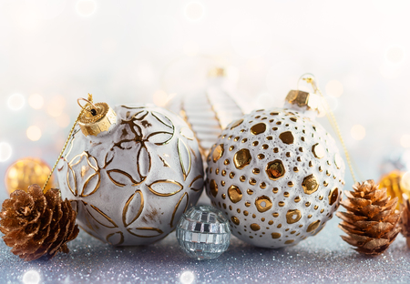 Christmas concept with silver bauble and fir cones Stock Photo