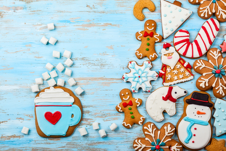 Assorted homemade Christmas  cookies  on a blue wooden background