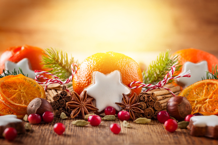 Christmas decoration with mandarins,cookies,berries and spices Stock Photo
