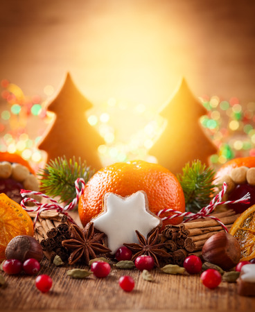 Christmas decoration with mandarins,cookies,berries and spices Standard-Bild