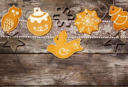 Christmas concept with cookies in rustic style on wooden background. Top view.