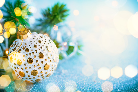 Christmas concept with silver and gold baubles and festive fir tree
