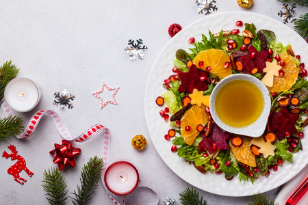 Christmas wreath salad with beetroot,apple,oranges and honey-mustard sauce. Stock Photo