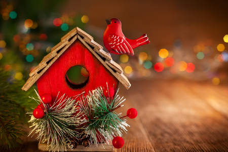 Christmas toy house on the wooden background Stock Photo