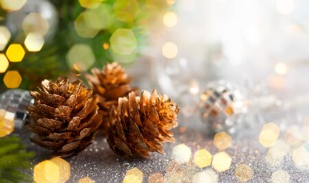 Christmas concept with silver bauble, fir cones and festive fir tree Banco de Imagens - 88502723