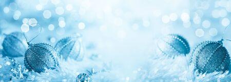 Christmas balls on blue sparkling background. Festive winter concept.