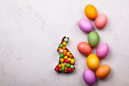 Easter concept with natural dyed easter eggs and candy. Flat lay