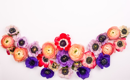 Festive flower composition made of fresh buttercups and anemone on the white background. Overhead view. Archivio Fotografico - 96925857