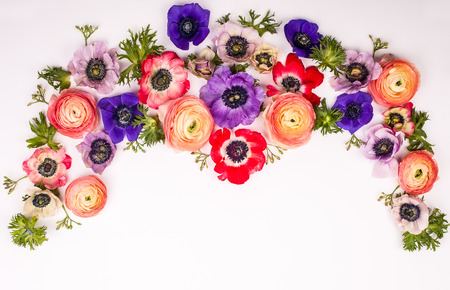 Festive flower composition made of fresh buttercups and anemone on the white background. Overhead view. Stock Photo