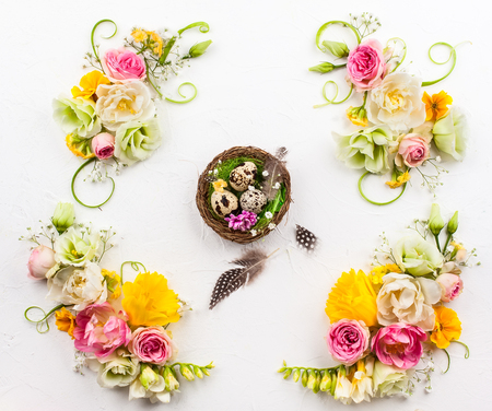 Easter composition with spring flowers,Easter eggs and nest. Easter concept with copy space. Top view