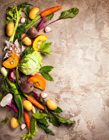 Variety of fresh raw vegetable ingredients for cooking of vegetable soup or stew. Autumn vegetable still life on rustic vintage background. Top view 写真素材