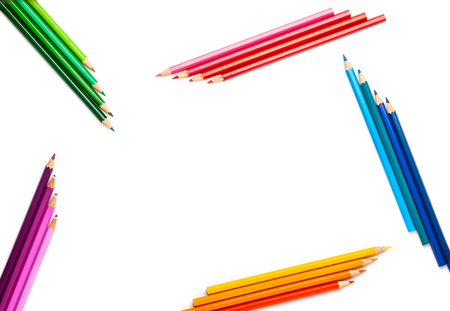 Colored pencils set on white background with copy-space . Back to school concept. Top view, flat lay.