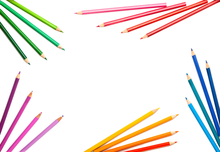 Colored pencils set on white background with copy-space . Back to school concept. Top view, flat lay. Foto de archivo