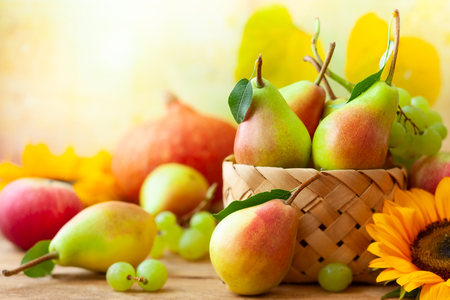Autumn still life with seasonal fruits,flowers and vegetables on wooden background. Archivio Fotografico - 107207129
