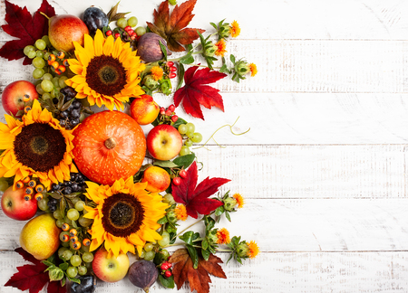 Thanksgiving background with autumn pumpkins, fruits and fall leaves on wooden table. Top view, autumn concept with copy space. Stock Photo