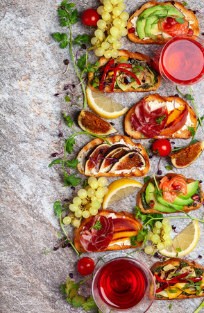 Set of assorted bruschetta  with various toppings for holiday on the stone board. Top view. Party food concept. Banque d'images - 107081774