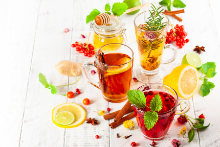 Assorted of healthy medical drinks  for autumn-winter season. Herbal tea with berries, spices, dried flowers and citrus.