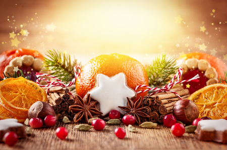 Christmas decoration with mandarins,cookies,berries and spices Banco de Imagens