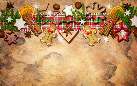 Christmas concept with cookies, spices and baking molds. Top view.