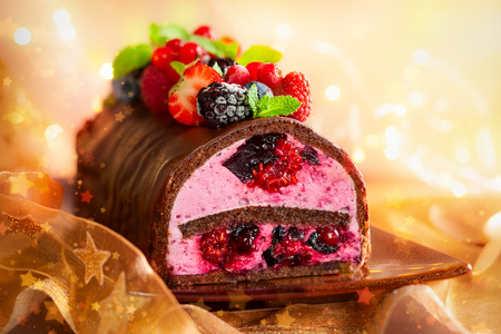 Christmas chocolate and berries log cake.