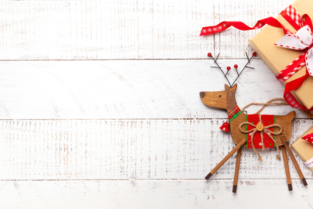 Christmas decoration and gift boxes on white wooden background. Reklamní fotografie