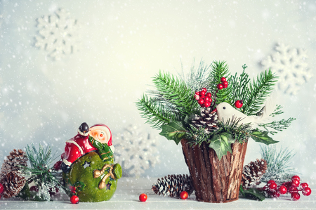 Christmas and New year still life with festive decor on the wooden background. Christmas bunch, snowflakes